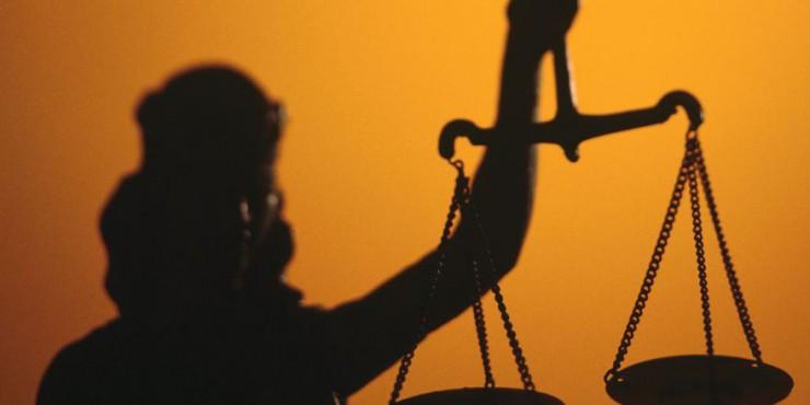 Пойманного на взятке $1000 полицейского приговорили к штрафу в 850 гривен