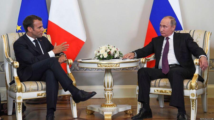 Макрон и Путин обсудили минские соглашения и Сенцова